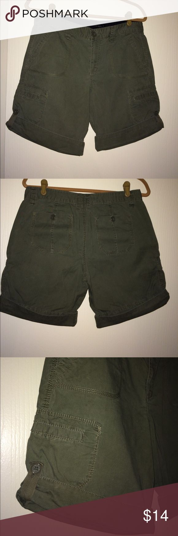 Calvin Klein Khaki Shorts Calvin Klein women's Khaki shorts. 6 pockets front, back, side. Button cuff to adjust length of shorts.  Size 8 ---- Color: Olive. Worn a couple of times, in great condition.  No pets, No Smoking, clean home. Calvin Klein Shorts