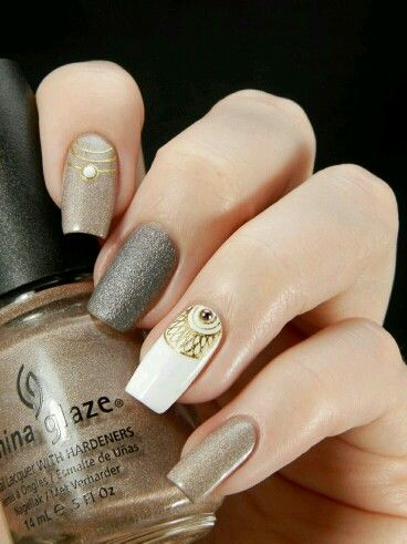 Bohemian Metallic Nails - Love the middle nail's texture
