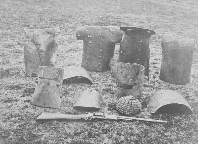Dan Kelly's and Steve Hart's armour recovered from the hotel at Glenrowan after it was burnt. Oswald Thomas photographer State Library of Victoria.