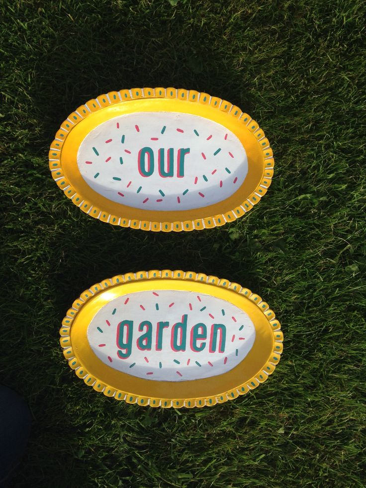 Wooden snack trays I painted and repurposed as signs for my sisters garden