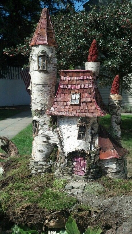 pretty spectacular fairy garden castle from birch logs/stumps