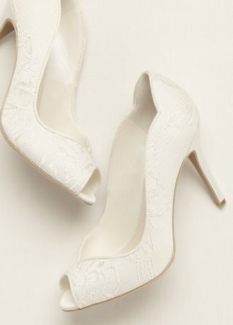 Stunningly simple yet elegant, these lace peep toe pumps are a chic choice for your special day!  Heel Height - 33/4 inch.  Available in Ivory.  Fully lined. Imported.