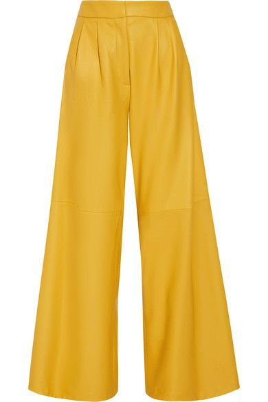 Adam Lippes' bold yellow pants are cut from leather in a dramatic wide-leg silhouette. They're detailed with flattering front pleats and drum-dyed for extra softness. We like the contrast of a midnight-blue top against the bright hue.