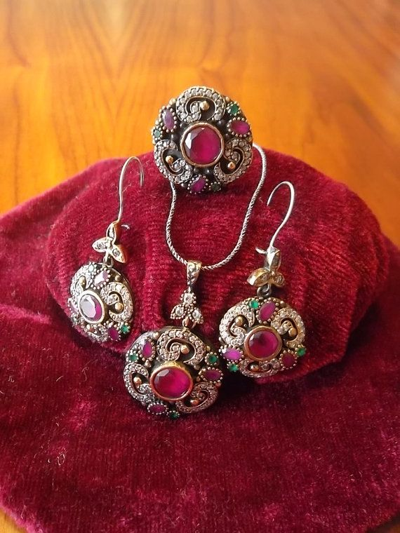 This fantastic jewelry set including two earrings, a ring and a necklace is made by Turkish handscraftmen inspired from Byzantine and Ottoman Empire Era. This set is made of real 925 sterling silver and rubies, emeralds and zirconia stones as shiny as real diamonds are fitted on the set. Total weight of set is 37.5 gr.  You can gladly use this set for a wedding ceremony, graduation party or for a diner you need to be dressy.