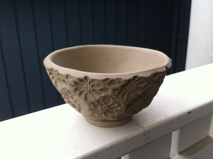 A little bowl with stamped patterns.