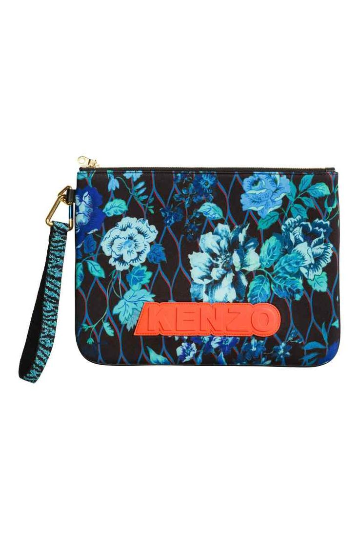 Patterned scuba pouch: KENZO x H&M. Sturdy pouch in scuba fabric with different patterns on the back and front and leather details. Rubber appliqué on one side, zip at the top and a detachable, tiger-striped fabric wrist strap that fastens to the pouch with a carabiner hook. Size 23.5x32 cm.