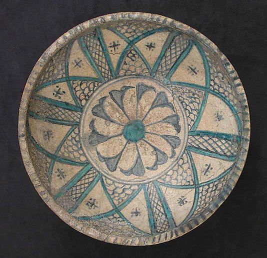 Bowl  Date:     13th century Geography:     Syria Medium:     Earthenware; glazed. Dimensions:     H. 4 1/4 in. (10.8 cm) Diam. 11 1/8 in. (28.3 cm) Classification:     Ceramics Credit Line:     Gift of Henry Walters, 1924 Accession Number:     24.159.4