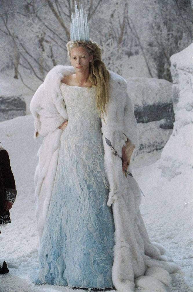 "The ""White Witch"" from The Lion, The Witch and the Wardrobe, designed by Isis Mussenden. The dress was made to look as though the witch had covered herself up in a bit of Narnia. The witch's outfit carries a lot of symbolism, in which the materials and fabrics were sourced from all over the world to create the effect it had. The first layer of the dress is a velvet dyed, the second layer is felted wool and silk, it is the sheen of the silk that created these icy lines...."