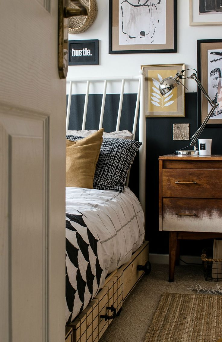 Gallery wall in small bedroom makeover. Half painted dark wall / Grillo  Designs www.