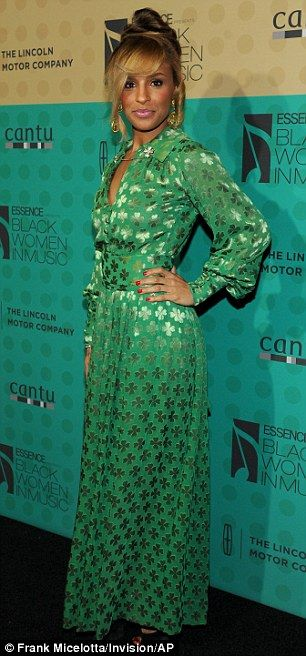 Lucky charm: Former Pussycat Dolls star Melody Thornton wore a vintage-inspired green dress