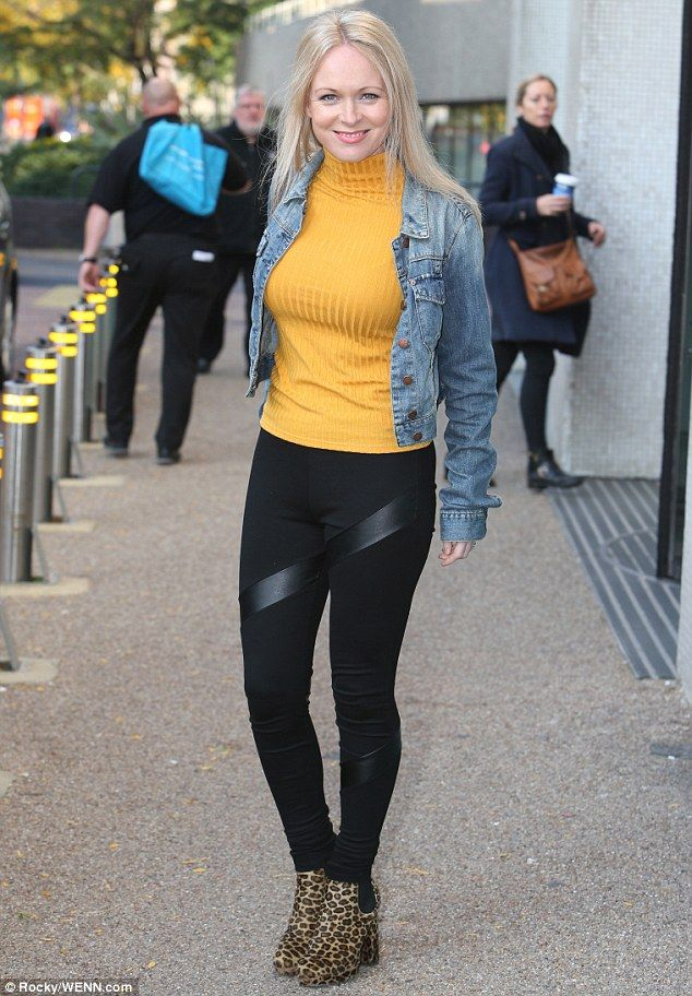 Simple but chic: She wore her soft blonde tresses in a straight style and rounded off her daytime look with a touch of coral-coloured lipstick and rosy cheeks