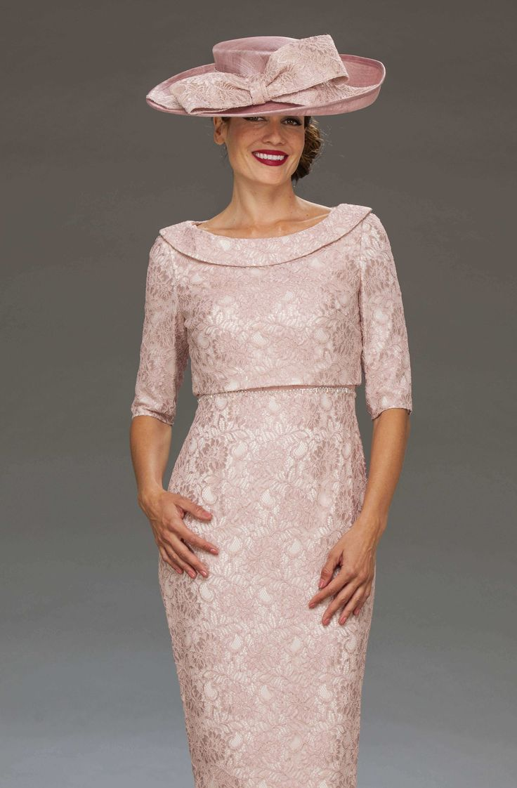 This short fitted dress features a pleat detail across the bust and a lace skirt. The outfit is completed with a matching lace design top that fastens to the back. Colours: Blush