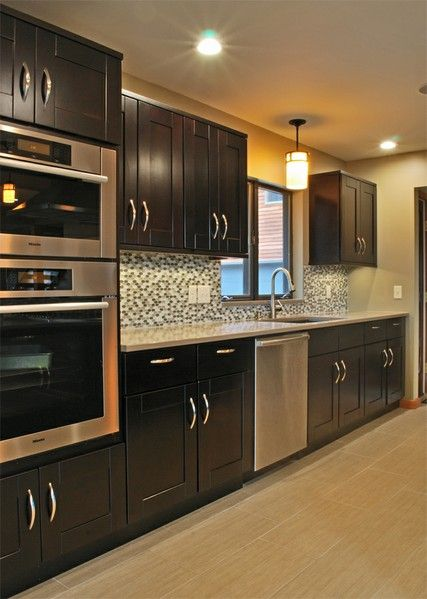 the back splash is beautiful with the dark cabinets