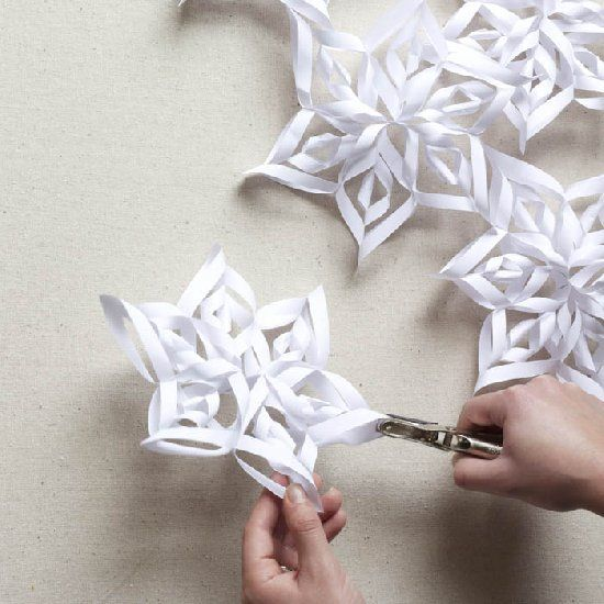 How to make 3D snowflakes--a cute, cheap, and easy winter project! I turned these ones into a garland for my mantel.