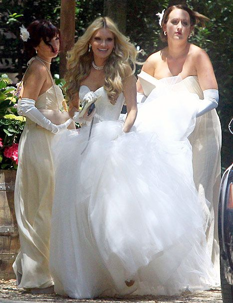 Lauren Parkesian arrives in her wedding dress for her Malibu, Calif. wedding ceremony to Aaron Paul on May 26, 2013.