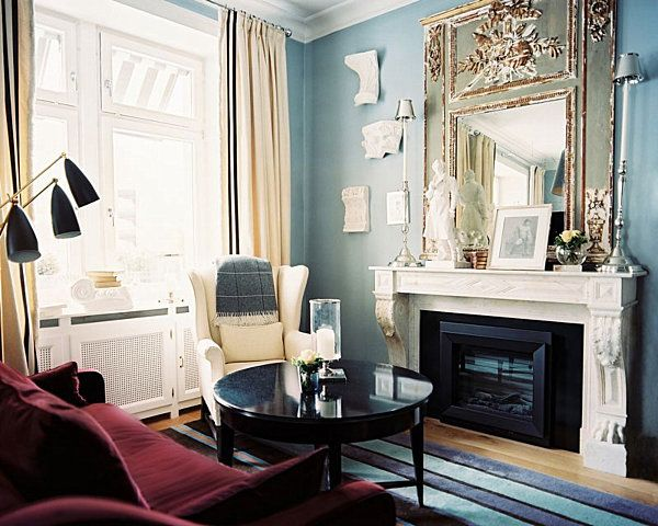 living room blue walls with green acent | In this next light blue living room, cream and gold are warm ...