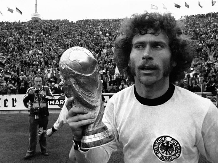 Paul Breitner holding the Rimet Trophy at the 1974 World Cup