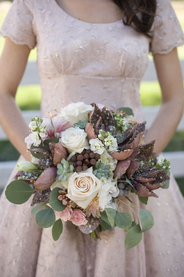 Bridal bouquet with hints of copper and blush pink. More touches of blue green and maybe some accents of orange and purple wildflowers.
