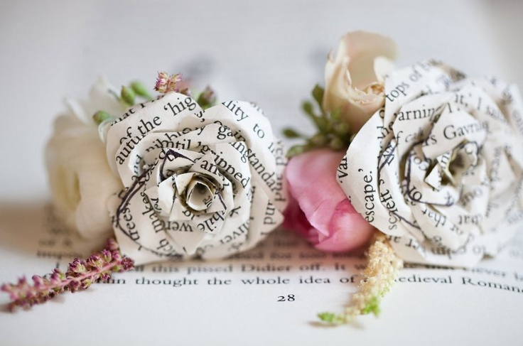 Pink anunculoius and paper flower boutineers made out of book pages. Flowers - www.intrigue-desi... Photos - www.lizandryan.com Paper & Design - www.allisonbarnhi... Vintage Rentals @2hands studios studios @Allison j.d.m Barnhill @Liz Mester and Ryan Bower (I am missing a number of vendors. This will be updated shortly to list everyone's credit)
