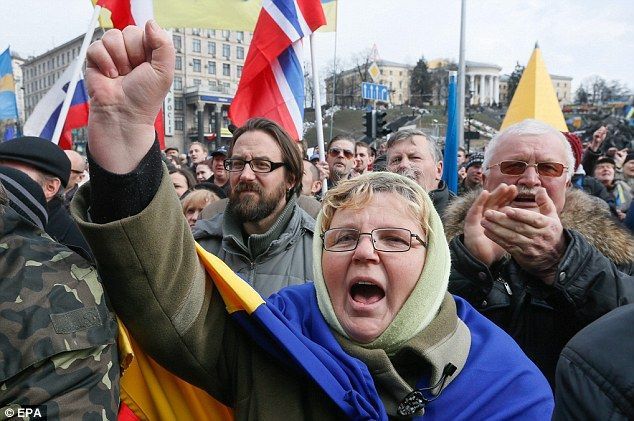 Ukrainians shout slogans during their rally on the Independence Square