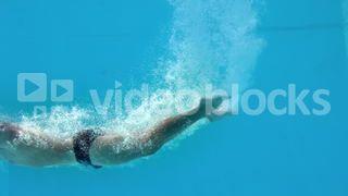 Fit man diving underwater in swimming pool Stock Video Footage - VideoBlocks