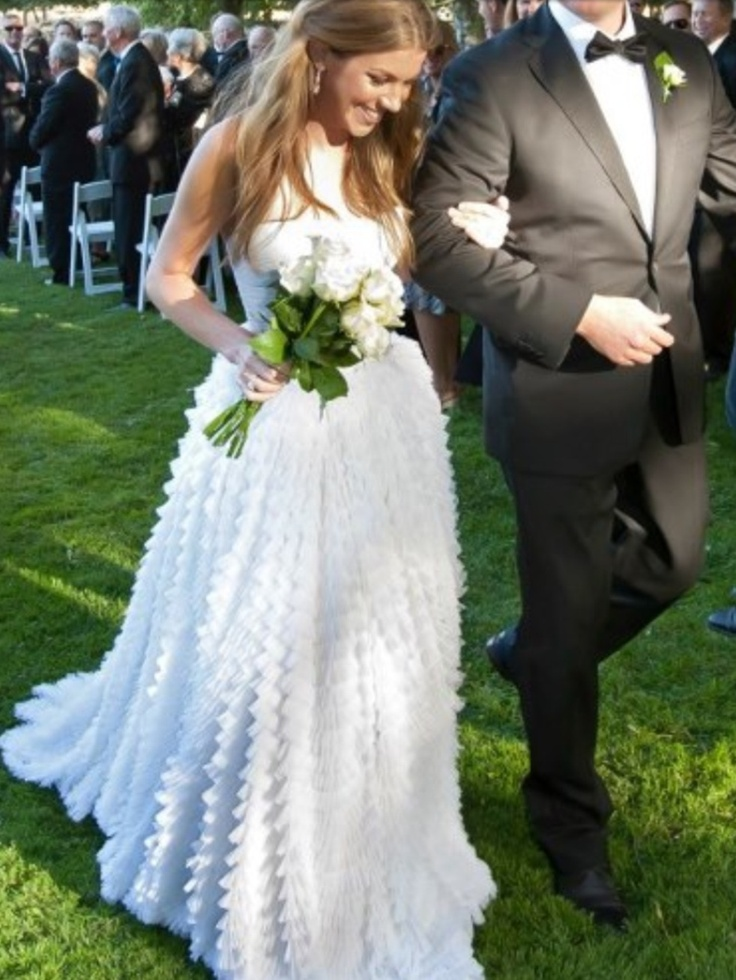 Koo wearing a beautiful strapless Jane Hill Wedding gown with a French tulle ruffled skirt