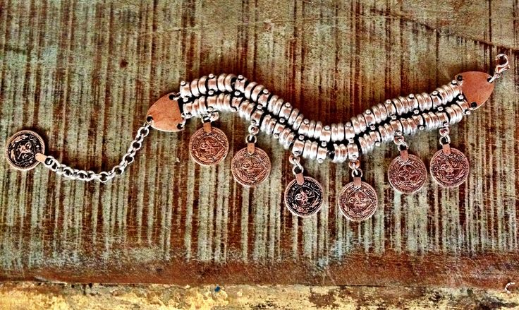 Turkish coin braceletsilverhandmadeadjustable (onesize)adorned with silver turkish coinshigh quality layer or stack with other bangles / braceletsyou will be jinglin' like a gypsy with one of these on your arm