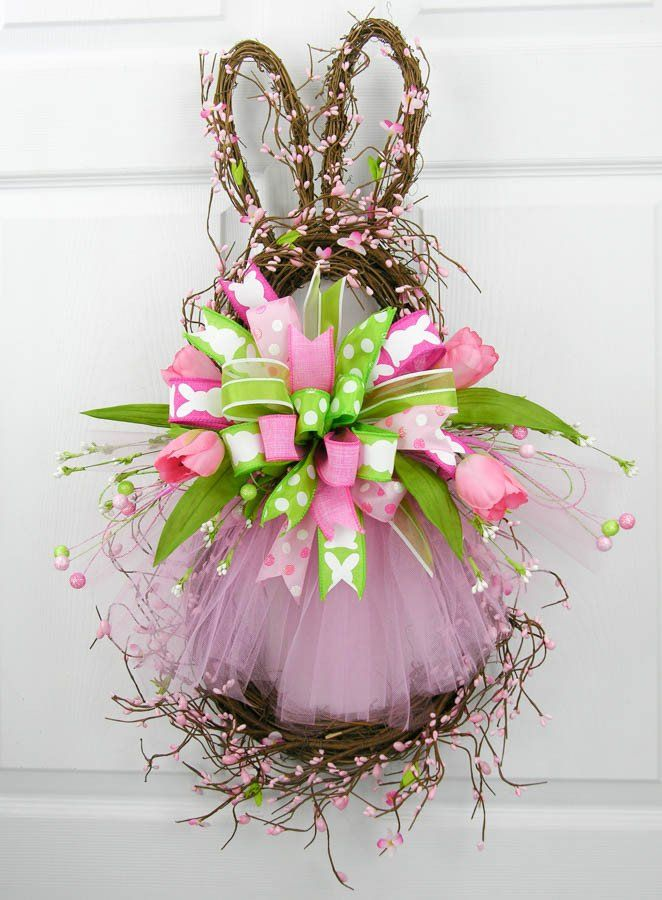 A vine and gypsum grapevine bunny with the cutest pale pink tutu. This wreath has a large pink/green Terri Bow in multiple patterns with accents of whispy glittered picks, tulips and and petite white