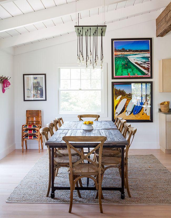 LOVE THE WHITE WOOD CEILING AND THE WARM WOOD MAIN SUPPORT BEAM. Ben Watt's Montauk Cottage #Hamptons