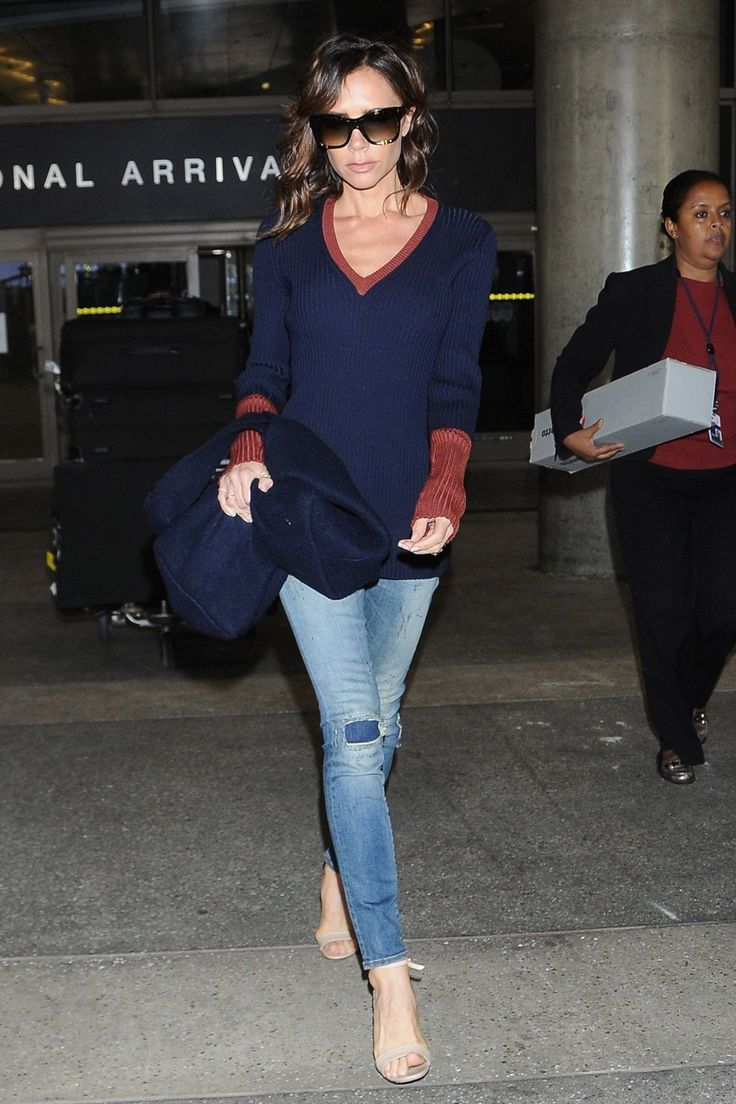 Victoria Beckham shows her stripes in the new look of casual, yet tailored dressing for the airport.
