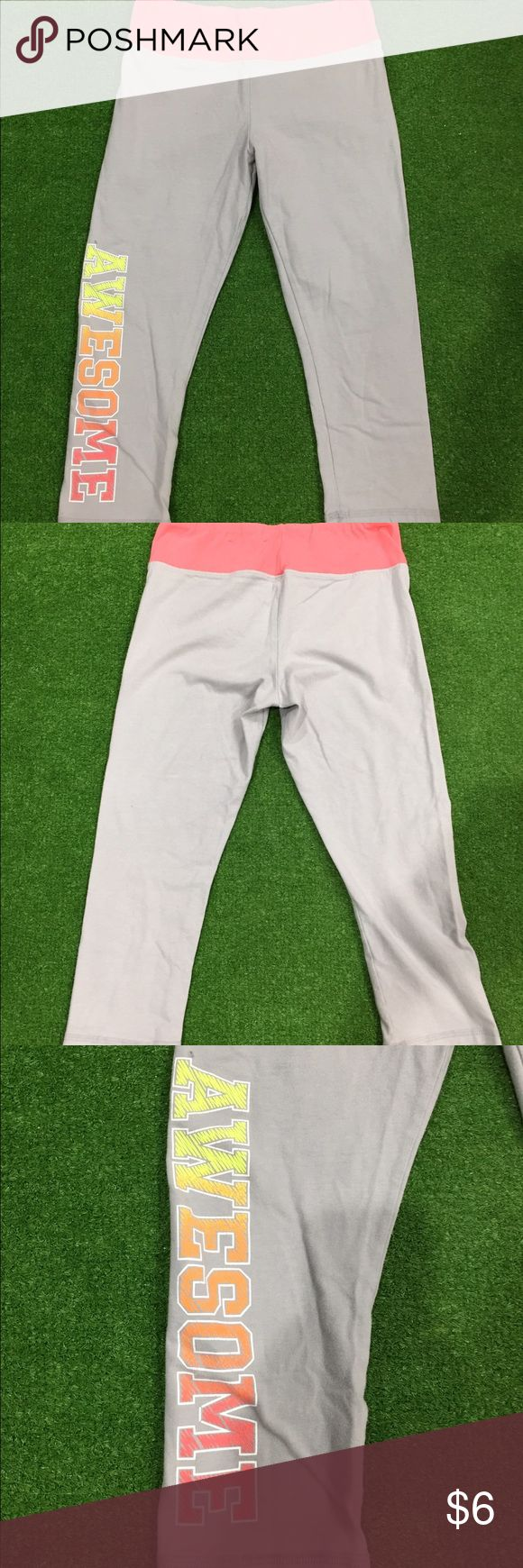 Pink and Gray Athletic Capris These are a size large and they say 'Awesome' down the leg. They're in great shape and very cute. Danskin Bottoms Leggings