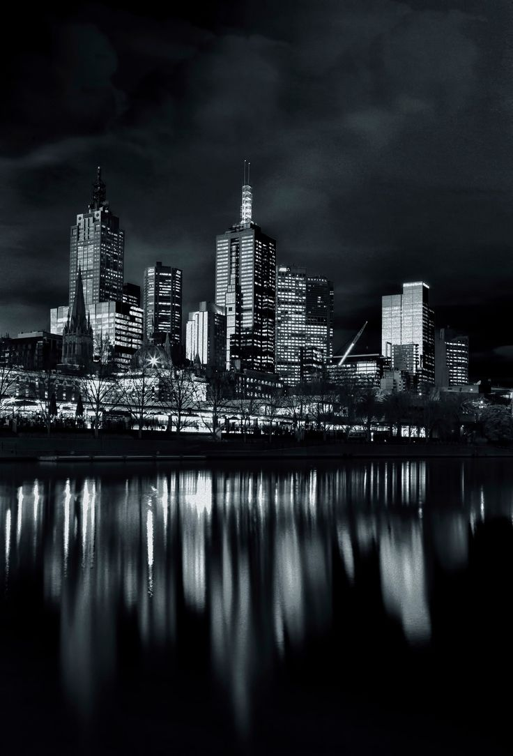 City architecture lights reflecting off the River - Beautiful cityscape reflecting off the river at night.