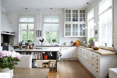 I love that this large kitchen with soaring ceilings is not overdone and overspent. Great space.