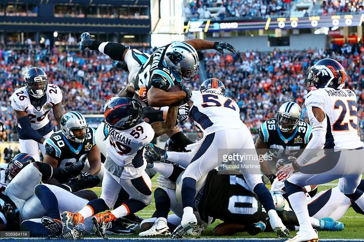 Jonathan Stewart #28 of the Carolina Panthers scores a touchdown against the Denver Broncos in the second quarter during Super Bowl 50 at Levi's Stadium on February 7, 2016 in Santa Clara, California.