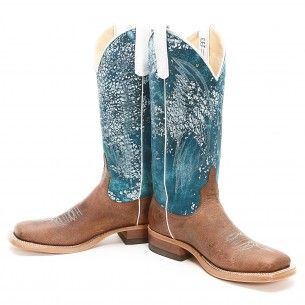 This womens boot features a distressed foot with a blue shaft