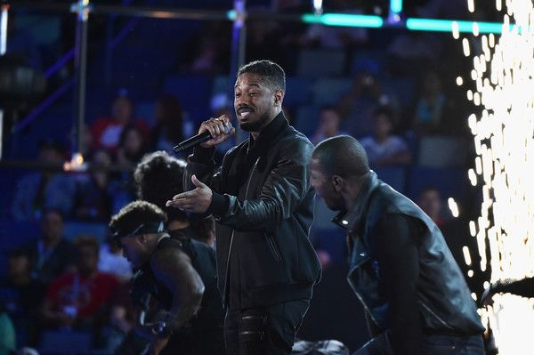 Michael B. Jordan Photos Photos - Actor Michael B. Jordan performs before the 66th NBA All-Star Game at Smoothie King Center on February 19, 2017 in New Orleans, Louisiana. - Celebrities Attend The 66th NBA All-Star Game