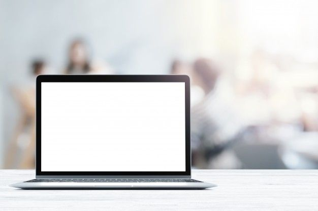 Laptop With Blank Screen Placed On White Wooden Table In Blurred People In Coffee Shop Or Restaurant Scroll Bar Wooden Tables Computer Table Design