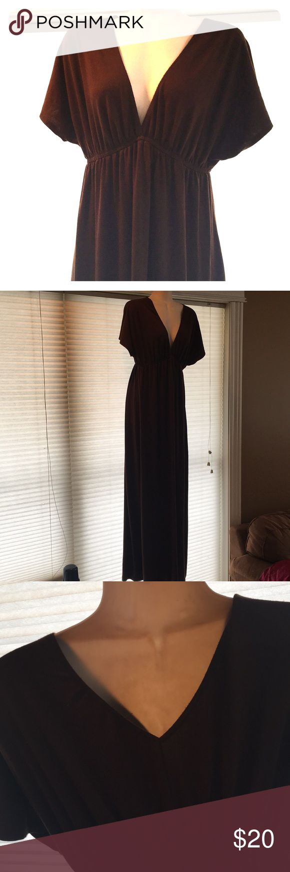 Long chocolate brown maxi dress size M Easy, breezy dark chocolate brown maxi dress.  V neck, elastic waist- endless options with belts or just as is!  Cute v back as well, see third image.  66% polyester, 29% rayon, 5% spandex- feels like a lightweight cotton but more durable material.  Very versatile! Dresses Maxi