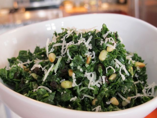 Melt In Your Mouth Kale Salad 1 bunch of lacinato or dinosaur kale, stems removed, rinsed and patted dry ⅓ cup currants (or chopped raisins) juice of one lemon 1 tbsp of olive oil 1 tsp local honey ½ cup pine nuts toasted salt and pepper to taste 4 tbsp grated raw parmesan cheese