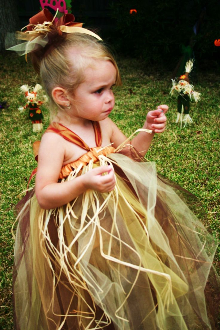 Scared Me Scarecrow  Tutu Dress Costume/buy on etsy or diy by tying long strands according to size of person, of autumn color tulle onto a headband, finish up by adding strands of raffia onto outer part; sew or pin straps onto top of dress