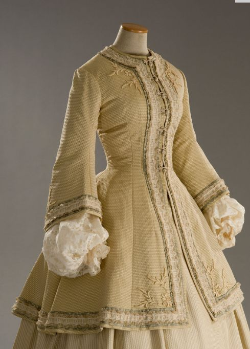 I wish we still dressed this way. OK, forget the corset, but SKIRT! JACKET! SLEEVES! Just look at the sleeves!