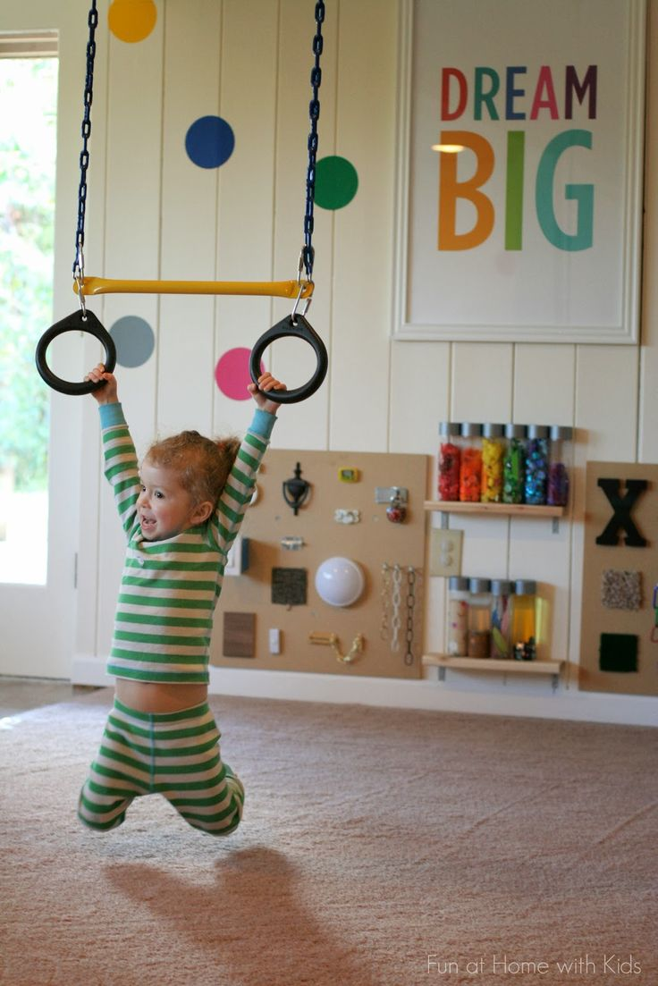 This is how I envision E's room to be. Playroom Design: DIY Playroom with Rock Wall from Fun at Home with Kids