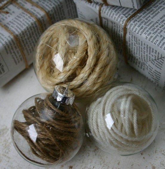 DIY Twine/Yarn Filled Ornaments. Very rustic looking...would look great on a traditional tree with white lights and pinecones.