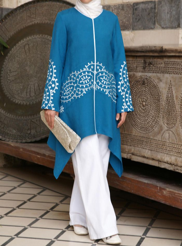 This unique tunic features dramatic Moroccan embroidery with a unique and flattering cut. Gorgeous and festive without being flashy or overpowering, this is the perfect top for special occasions� or for when you want to just feel special. Easily paired with Pants or a skirt for equally elegant looks.