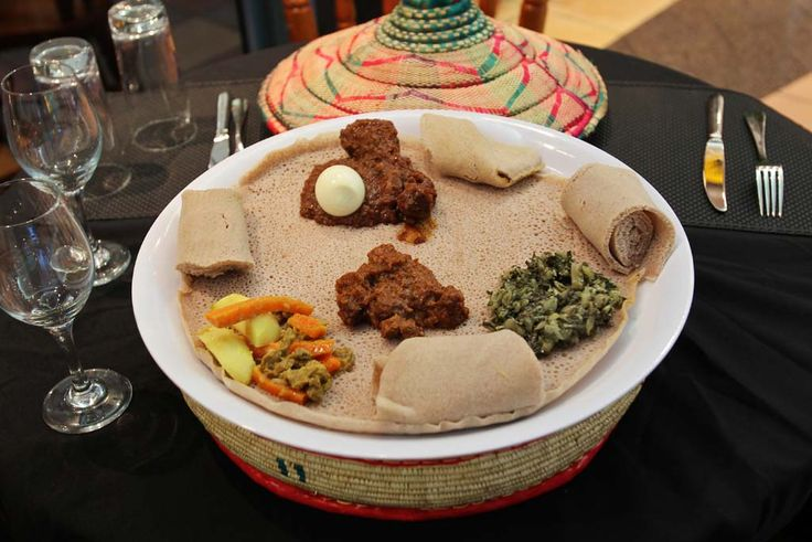 Jambo Jambo African Restaurant, Crows Nest. Platter with, Doro Wot (chicken), Key Wot (beef, hot), Alicha Wot (beef mild) and Gomen (collard greens) served with injera (bread).
