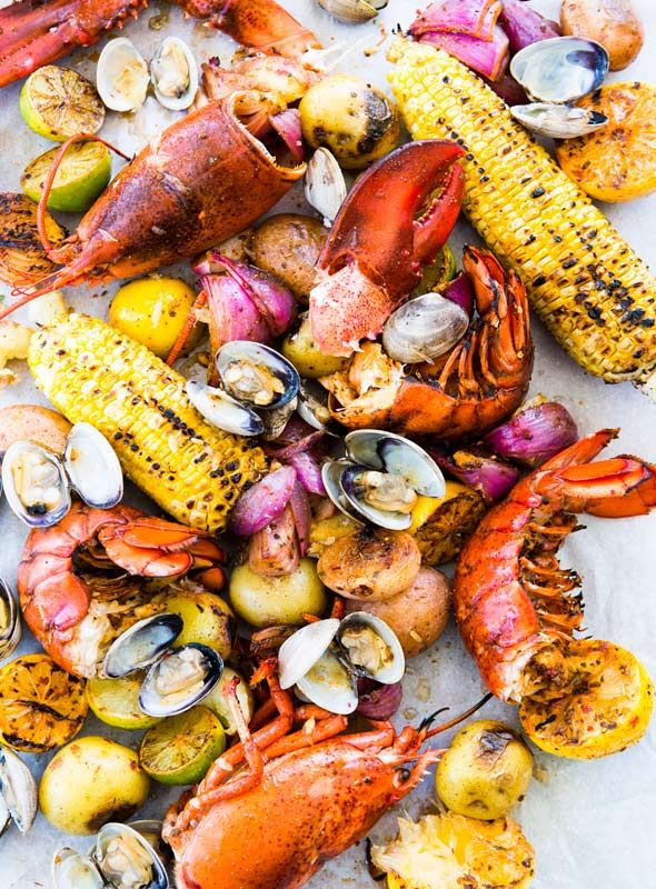 New England Clambake Recipe (The problem with New England clambakes? You have to be in New England to partake. Until now. This New England clambake recipe, made with clams, lobster, Old Bay, sweet corn, and potatoes, works its magic in the oven rather than at the beach.)