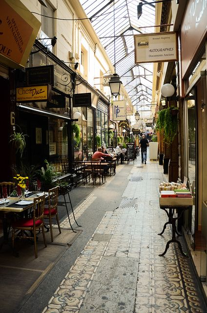 "Passage des Panoramas, Paris II   ""The Passage des Panoramas is a roofed commercial passageway located in the IIe arrondissement, of Paris between the Montmartre boulevard to the North and Saint-Marc street to the south. It is one of the earliest venues of the Parisian philatelic trade, and it was one of the very first covered, airy commercial passageways in the world."""