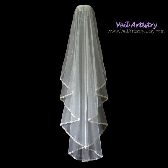 Ready-to-Go Veil. Contrasting colors define this stunning slender veil. This Sunbeam style veil falls in radiating folds that cascade down the