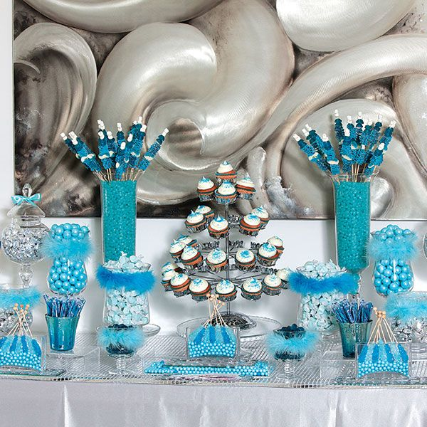 "Blue candy buffet, ""There's so much i love about candy tables — or candy bars, as I like to call them,"" says Los Angeles wedding planner Wayne Gurnick. Styling a standout candy bar takes preparation and thought, he says. ""the goal is for everyone to see the candy as a visual treat before they even get near it."""