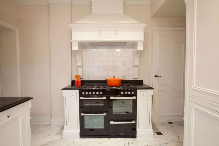 Traditional bespoke kitchen with range cooker and luxury kitchen utensils | JHR Interiors